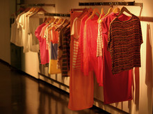 Artwork Of The Show Room With Regals Full Of Light And Comfortable Clothes