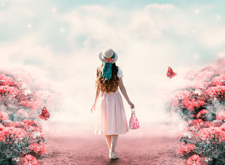 Fototapeta Vintage Young lady woman in romantic dress, hat with bag in retro style walking along summer rose field path and flying butterfly. Idyllic tranquil fantasy scene. Travel across fairy tale hills