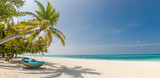 Fototapeta Fototapety z morzem do Twojej sypialni - Tropical beach panorama as summer landscape with beach swing or hammock and white sand and calm sea for beach banner. Perfect beach scene vacation and summer holiday concept. Boost up color process