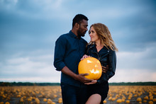 Couple Standing In Pumpkin Fie...