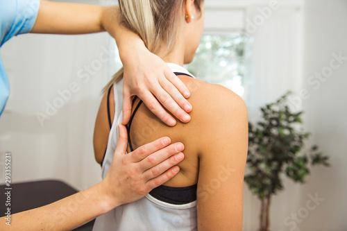Fényképezés A Modern rehabilitation physiotherapist at work with client