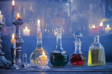 Magic Potions In Bottles On Wo...