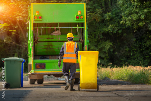 Fototapety, obrazy: Recyclable garbage truck and the keeper  in the village.