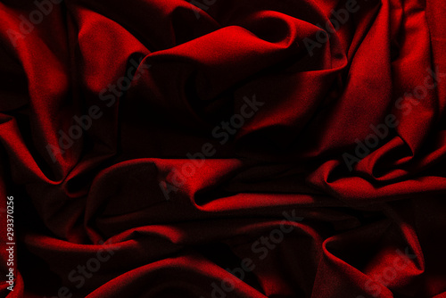 Dark red wrinkled fabric, With lights falling into patterns, Art background caused by fabric. - 293370256