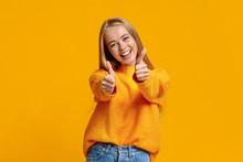 Joyful Teenage Girl Showing Th...