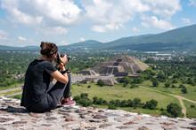 Tourist Taking Photos Of Tehotihuacan