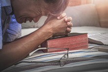 Close Up Young Christian Praying On Old Bible, Want To Help From God . Christian Sorrowful Concept.