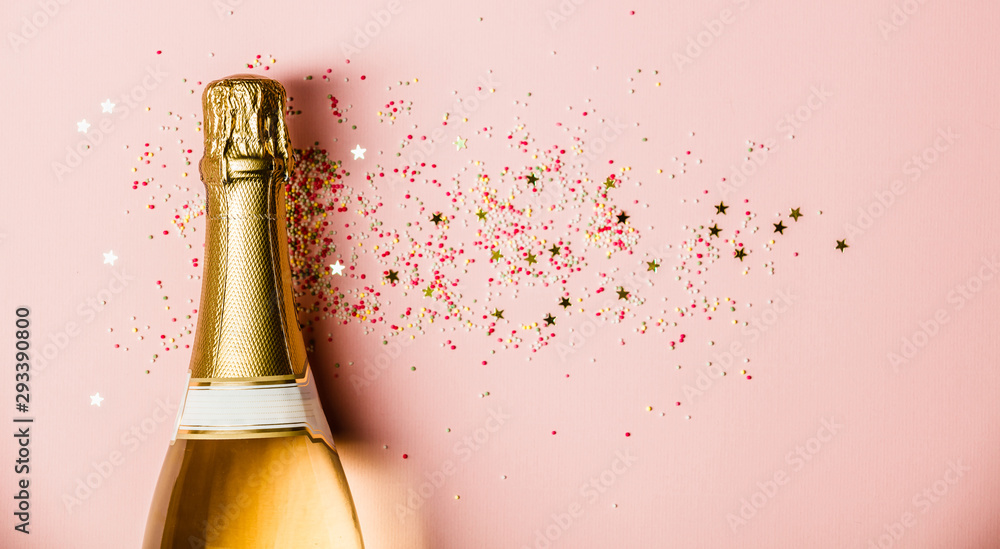 Fototapety, obrazy: Flat lay of Celebration. Champagne bottle with sprinkles on pink background.