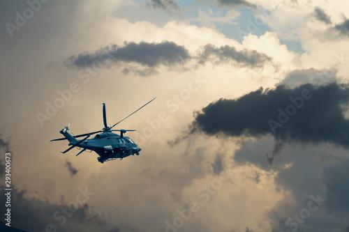 Photo Elicottero militare AW149 in volo in cielo tempestoso