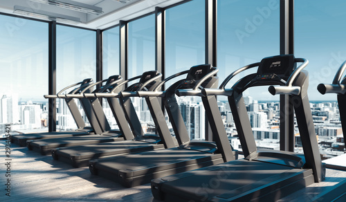 Modern gym with Treadmills near big panoramic windows in skyscraper, 3d rendering Canvas Print