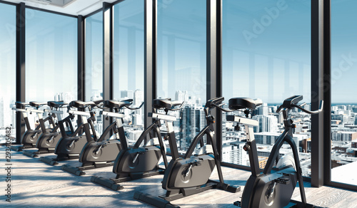 Photo  Modern gym with exercise bikes near big panoramic windows in skyscraper, 3d rendering