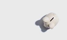 A White Piggy Bank Overhead View Flat Lay