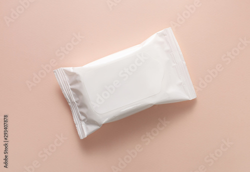Fotografija Packing a white pack of wet wipes on a pink background
