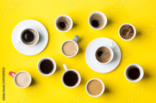 Fotomural  Creative flat lay with assortment of coffee cups