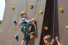 A Boy In Climbing Equipment Co...