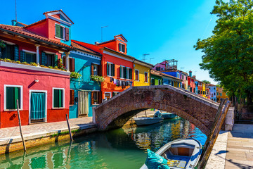 Street with colorful buildings in Burano island, Venice, Italy. Architecture and landmarks of Venice, Venice postcard
