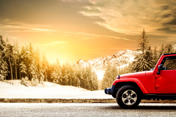 Red winter car and landscape of mountains