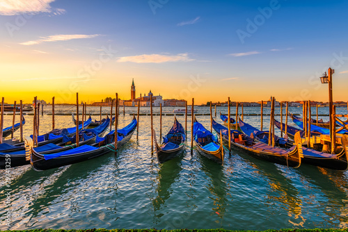 Poster Gondoles Sunrise in San Marco square, Venice, Italy. Architecture and landmarks of Venice. Venice postcard with Venice gondolas