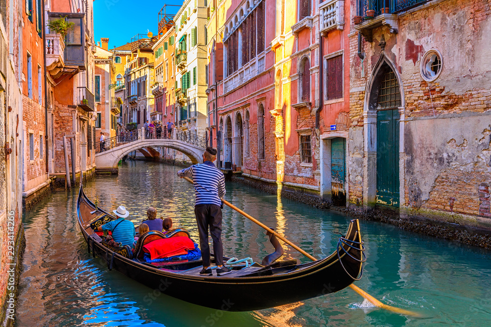 Fototapety, obrazy: Narrow canal with gondola and bridge in Venice, Italy. Architecture and landmark of Venice. Cozy cityscape of Venice.