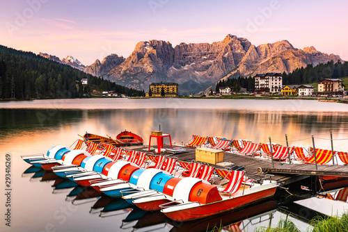 Beautiful Sunrise over Lake Misurina with Colorful Boats and Glowing Mountains P Canvas Print