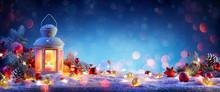 Christmas Lantern On Snowy Tab...