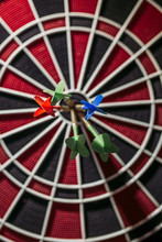 Close-up Of Darts In Bull's Eye Of Electronic Dartboard