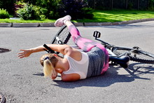 Fall From The Bike. A Woman Fe...