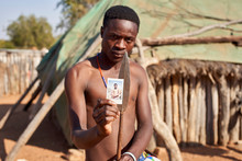 Mudimba Tribe Man Showing Picture Of Himself