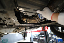 Black Jet Of Used Engine Oil D...
