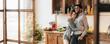 Leinwanddruck Bild - Young loving couple having good time at christmas morning