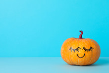 Pumpkin With Smile On Blue Bac...