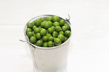 Green Pea Pod, Green Peas In White Bucket, White Background, Close Up, Concept Of Healthy Eating