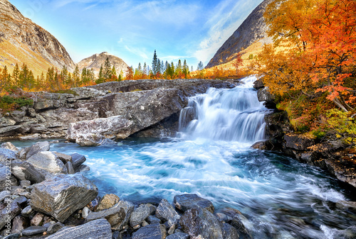 Foto auf Leinwand Himmelblau Beautiful autumn landscape with yellow trees and waterfall