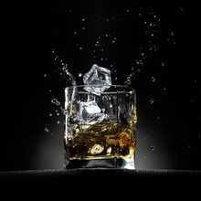 Glass Of Whiskey With Ice Cube...