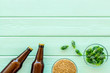 canvas print picture - Barley and hop for making beer on green wooden background top view copy space