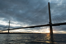 Queensferry Crossing Bridge At Sunset. The Bridge Is Spanning Over Firth Of Forth Bay. Scotland, UK.