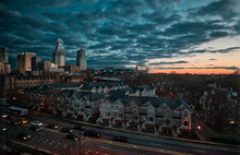 Buildings In Charlotte Against Cloudy Sky During Sunset