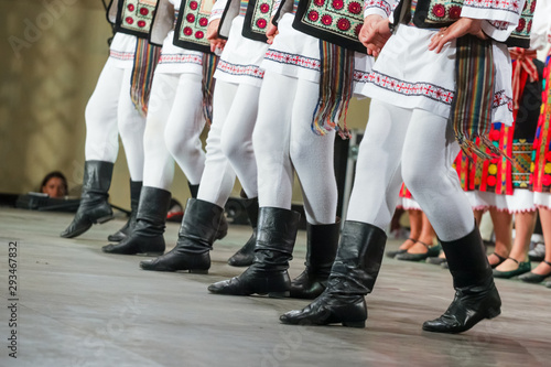 Photo  Close up of legs of young Romanian male dancer in traditional folkloric costume