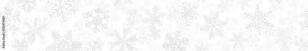 Fototapeta Christmas horizontal seamless banner of many layers of snowflakes of different shapes, sizes and transparency. Light gray on white