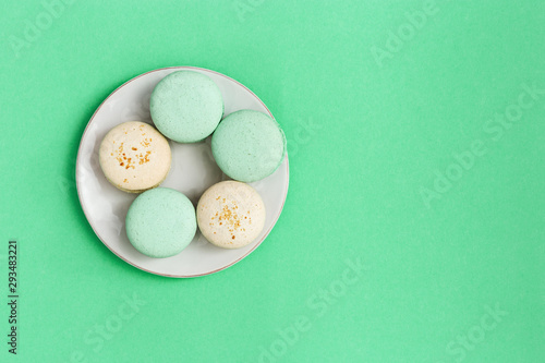 Fotobehang Macarons Top view on plate with biscuits macaroon different colors and taste. Mint and almond cookies. Fashion Delicious dessert.