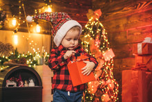 Family Holiday. Merry And Bright Christmas. Lovely Baby Enjoy Christmas. Santa Boy Little Child Celebrate Christmas At Home. Wish List. Childhood Memories. Boy Cute Child Cheerful Mood Christmas Gift