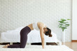 Athletic Asian woman practice yoga Cow pose to meditation in bedroom after wake up in the morning Feeling so comfortable and relax,Healthcare Concept
