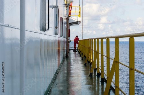 Canvas Print An unidentifiable offshore worker onboard a construction barge at oil field