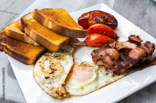 Australian breakfast with fried eggs, bacon, tomatoes and toasts. Canvas Print