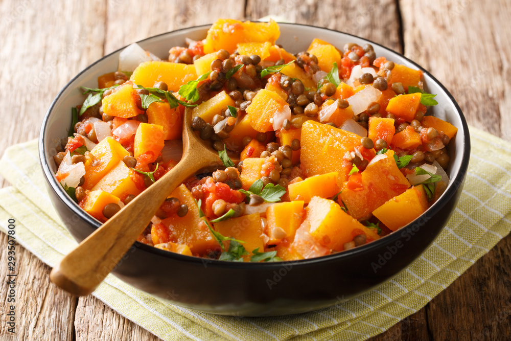 Fototapety, obrazy: Low-calorie hot stew of pumpkin, lentils, onions and carrots close-up in a bowl. horizontal