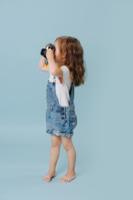 Little Girl Is Taking An Image...