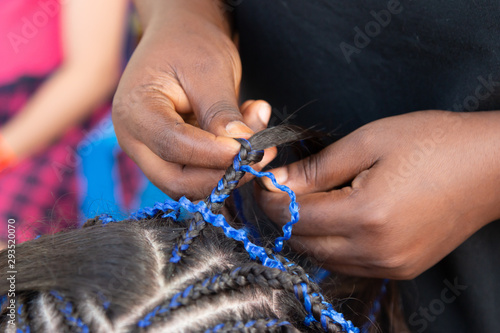 weaving thin braids on the head
