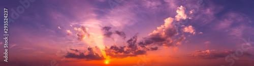 Obraz Panorama Sunlight with dramatic sky. Cumulus sunset clouds with sun setting down on dark background.Vivid orange cloud sky. - fototapety do salonu