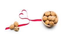 Three Nuts A Day For Heart Health, Walnuts On Bowl On White Background