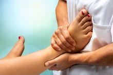 Physiotherapist Massaging Huma...